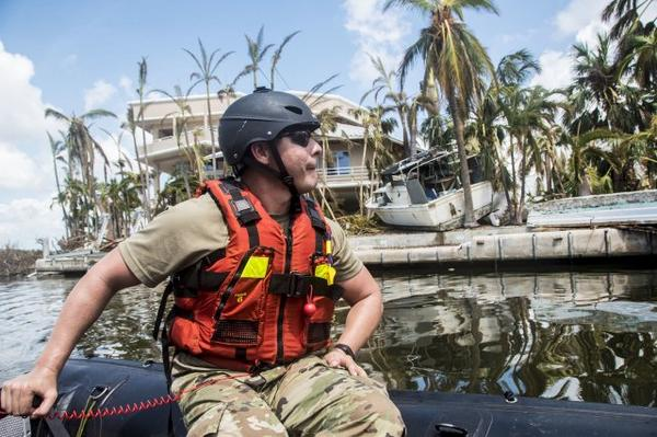 Army Sgt. Jonathan Mazella, a swift water tech, encounters severe damage in Scout Key while on a maritime reconnaissance mission with the Florida National Guard's Chemical Biological Radiological Nuclear Emergency Response Force.