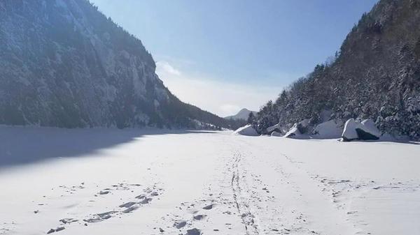 Ski tracks and boot prints across Avalanche Lake.