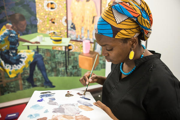 Njideka Akunyili Crosby paints in her Los Angeles studio in September 2017.