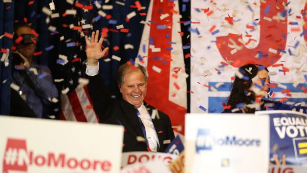 Democratic Sen.-elect Doug Jones greets supporters during his election night gathering last month.
