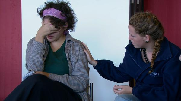 Ayana Lekach (L) is comforted by Rotem Dar (R) in the documentary <em>In the Land of Pomegranates</em>.