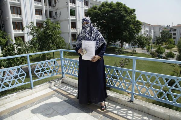 Lawmaker Naeema Kishwar Khan, who represents a conservative Islamic party, holds up the transgender rights bill she submitted to Pakistan's Parliament in August. It provides for the establishment of separate jail cells, enshrines their right to medical treatment and education, penalizes discrimination and mandates a quota of government jobs.