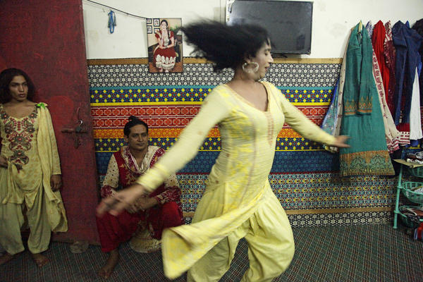 Transgender women dance for visitors in an apartment where they live together in Lahore.