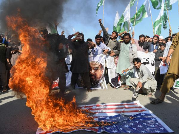 "Demonstrators shout anti-U.S. slogans at a protest in Karachi, Pakistan, on Tuesday, a day after President Trump tweeted that Pakistan has ""given us nothing but lies & deceit, thinking of our leaders as fools."""