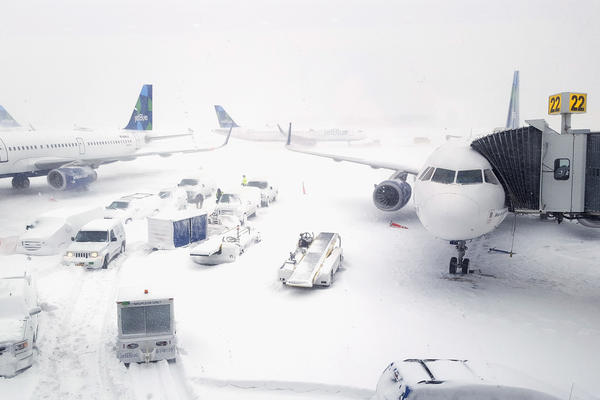 Airplanes wait at the gates outside Terminal 5 at John F. Kennedy International Airport in New York City on Thursday.