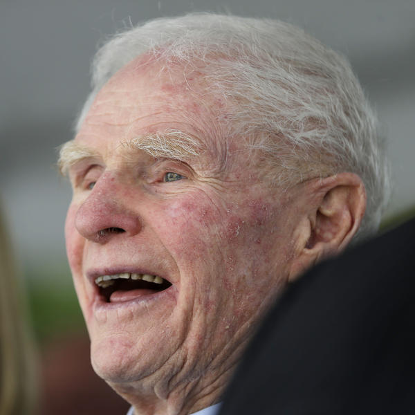 Former New Jersey Gov. Brendan Byrne laughs at a comment by New Jersey Speaker of the House Sheila Oliver during an event to unveil a statue of Byrne at the Essex County Courthouse, Thursday, in Oct. 2013, in Newark, N.J.
