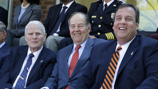 New Jersey Gov. Chris Christie, right, sits with former Governors Brendan Byrne, left, and Thomas H. Kean, Sr., at the opening of a new prisoner re-entry center in Sept. 2014, in Jersey City, N.J.