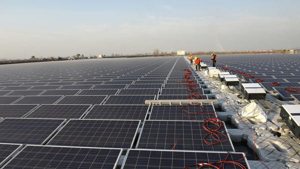 A photovoltaic plant is under construction above a pond at the mining subsidence area in Nihe Town in December in Huainan, Anhui province, China.