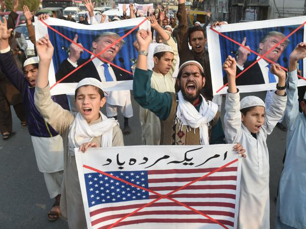 Demonstrators take part in a protest against U.S. aid cuts, in Lahore, Pakistan, on Friday.