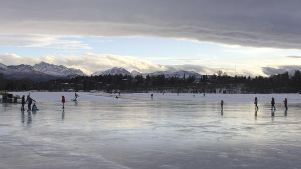 Ice skaters in Anchorage, Alaska, take advantage of higher than average temperatures at Westchester Lagoon.