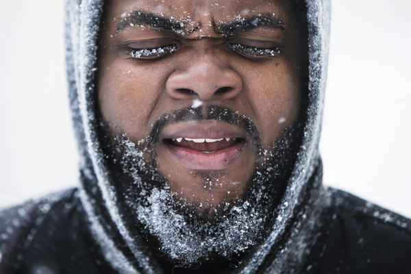Ajamu Gumbs makes his way to a bus station in Atlantic City, N.J., on Thursday. A winter storm is traveled up the East Coast.