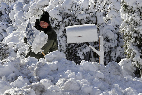 J.J. Laprise shovels his driveway in Scituate, Mass., on Friday. Frigid temperatures, some that could feel as cold as minus 30 degrees, moved across the East Coast as the region attempted to clean up from a massive winter storm.
