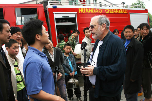 Robert Siegel talks with Xiaoyu Xie, a pianist who grew up in Chengdu in China's Sichuan province, during a reporting trip in 2008. Siegel and other <em>All Things Considered</em> staff were there when a devastating magnitude 7.9 earthquake struck.