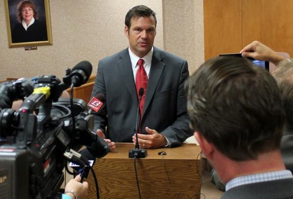 Kansas Secretary of State Kris Kobach filed charges against two people on Thursday contending they vote twice in the 2016 election.