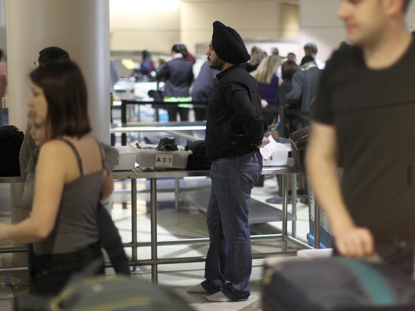 Travelers pass through security at Los Angeles International Airport in 2014.