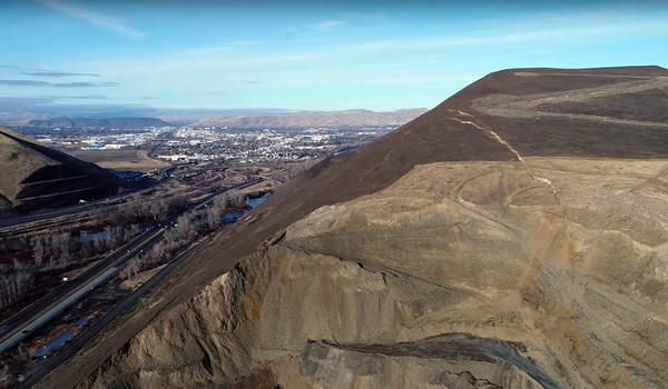 The Yakima River and Interstate 82 lay next to Rattlesnake RIdge, where cracks in the hillside have geologists worried a major landslide could occur. The town of Union Gap, Washington, can be seen in the background.