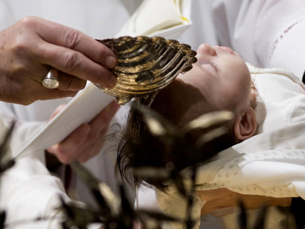 Pope Francis baptized 34 babies Sunday in an annual ceremony in the Sistine Chapel. He repeated advice from previous years: mothers should feel free to breastfeed during the service.