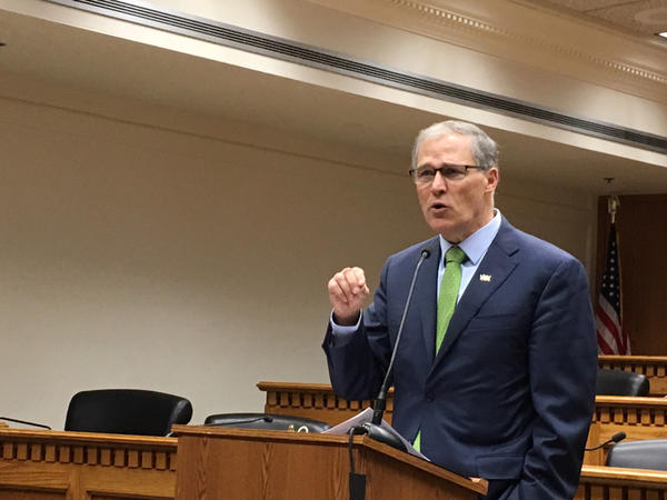 Washington Gov. Jay Inslee is calling on lawmakers to pass a carbon tax, a series of gun-related measures and repeal the death penalty during the 2018 legislative session.