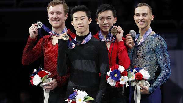 Nathan Chen, foreground, smiles after winning the men's skate event between Ross Miner, left, who finished second, Vincent Zhou, second from right, who finished third, and Adam Rippon, who finished fourth, at the U.S. Figure Skating Championships in San Jose, Calif., Saturday.