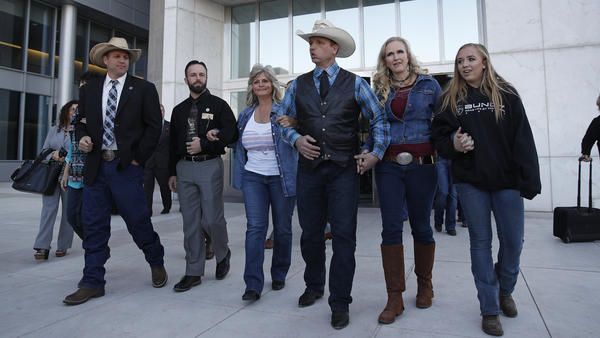 "Ammon Bundy (from left), Ryan Payne and Ryan Bundy on the day a mistrial was declared last month. They were joined by Jeanette Finicum, widow of Robert ""LaVoy"" Finicum, and Ryan's wife and daughter."