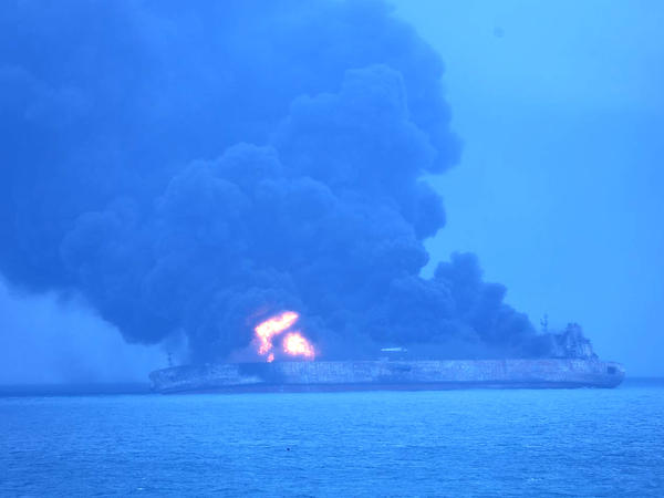 In this photo provided by Korea coast guard, the Panama-registered tanker Sanchi is seen ablaze after a collision with a Hong Kong-registered freighter off China's eastern coast on Sunday.