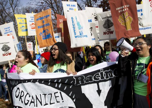 Demonstrators march during an immigration rally in support of the Deferred Action for Childhood Arrivals, DACA, and Temporary Protected Status, TPS, programs on Capitol Hill in Washington in December.