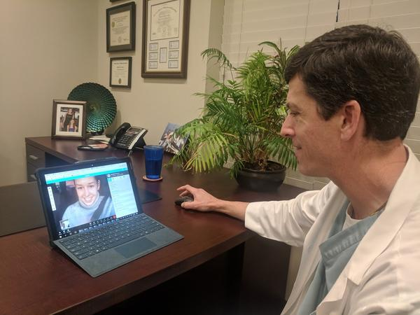 Dr. Daniel Mcdyer demonstrates his Epic MD software with one of his office managers.