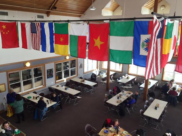 Flags in the School for International Training dining hall, pictured here in February 2017. The school has announced it will eliminate its Brattleboro program.