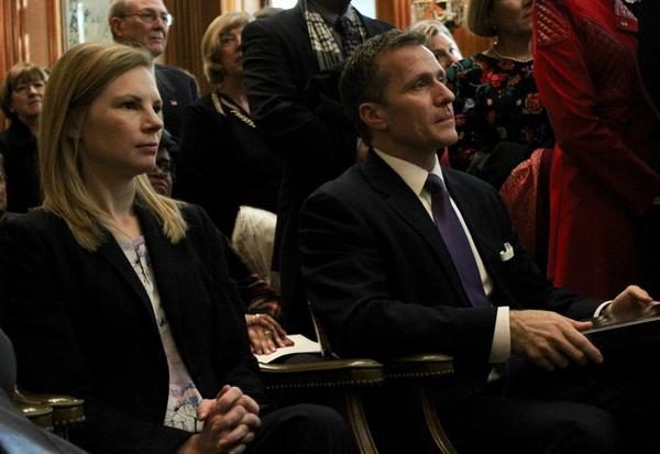 State Auditor Nicole Galloway and Gov. Eric Greitens listen during a ceremony revealing Gov. Jay Nixon's gubernatorial portrait on Jan. 4, 2018.