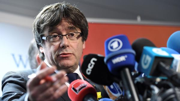 Ousted Catalan President Carles Puigdemont speaks at a press conference in Belgium last month, after a snap election in Catalonia gave pro-independence factions a slim majority in the regional parliament.