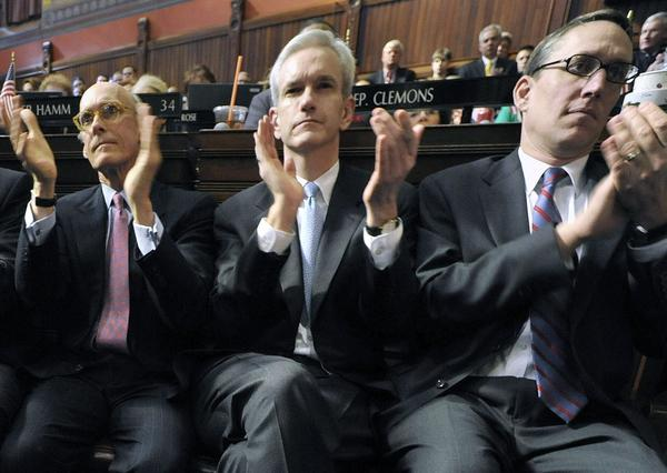 Andrew McDonald, center, then-legal counsel, applauds between Chief of Staff Timothy Bannon, left, and Budget Director Benjamin Barners as Gov. Malloy speaks at the Capitol in Hartford in 2011.