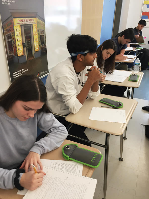 "Students in one Newton North High School class are required to lock their phones in pouches during class, but many still keep them close for ""comfort."""