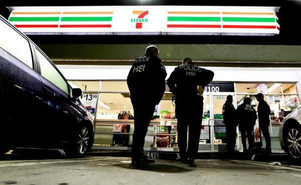 <p>U.S. Immigration and Customs Enforcement agents serve an employment audit notice at a 7-Eleven convenience store Wednesday, Jan. 10, 2018, in Los Angeles.</p>