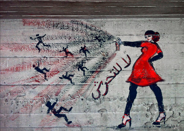 """This graffiti in a neighborhood in Cairo is emblazoned with the words """"no harassment"""" in Arabic."""