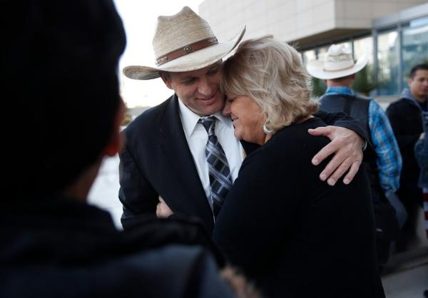 <p>Ammon Bundy, left, hugs is aunt Lillie Spencer outside of a federal courthouse in Las Vegas following the mistrial declaration.</p>