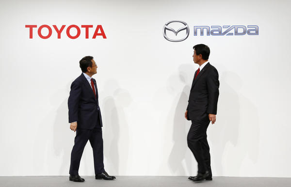 Toyota Motor Corp. President Akio Toyoda, left, and Mazda Motor Corp. President Masamichi Kogai. The rivals will build a joint manufacturing plant in Alabama.