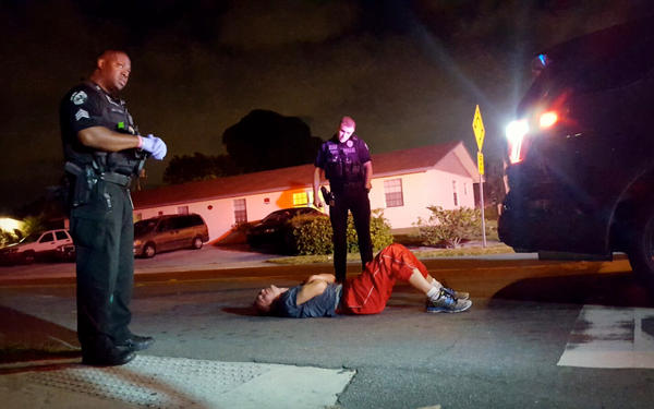A man convulses in the street from a heroin overdose two blocks away from the Delray Beach Police Station. Nov. 18, 2016.