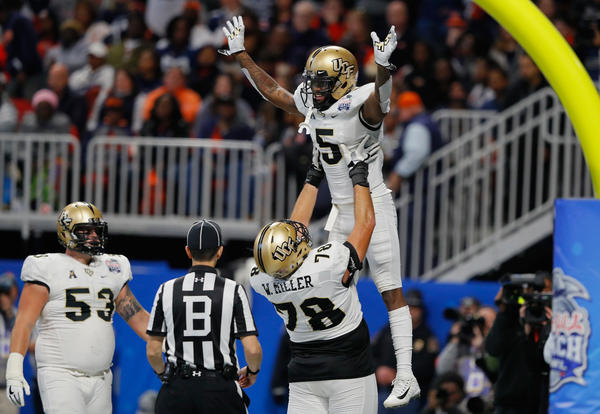 The University of Central Florida's Dredrick Snelson gets a lift after a touchdown against Auburn in the Peach Bowl earlier this month. Not pictured: the Alabama Crimson Tide, targets of a trolling campaign by some very determined UCF fans.