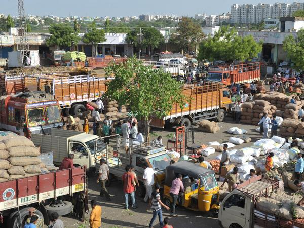Indian traders and vendors negotiate prices at a wholesale vegetable market in Hyderabad. The Indian economy grew at 7.1 percent for the 2016-2017 financial year.