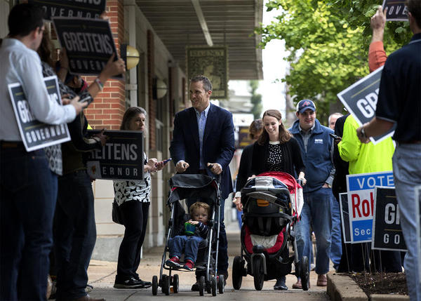 Eric and Sheena Greitens prepare to vote in the Central West End on Nov. 8, 2016. Once he declared his candidacy for governor, Eric Greitens' campaign messages prominently featured his wife and children.