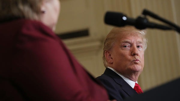 "President Trump listens as Norwegian Prime Minister Erna Solberg speaks at a joint news conference Wednesday. At an Oval Office meeting on immigration policy, Trump said the U.S. should want more people from countries like Norway, disparaging Haiti and what he called ""shithole countries"" in Africa."