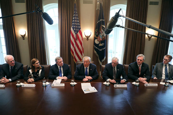President Donald Trump presides over a meeting about immigration with Republican and Democrat members of Congress, including (L-R) Senate Majority Whip John Cornyn (R-TX), Rep. Martha McSally (R-AZ), Senate Minority Whip Richard Durbin (D-IL), House Minority Whip Steny Hoyer (D-MD), House Majority Leader Kevin McCarthy (R-CA) and Sen. James Lankford (R-OK) at the White House on Tuesday.