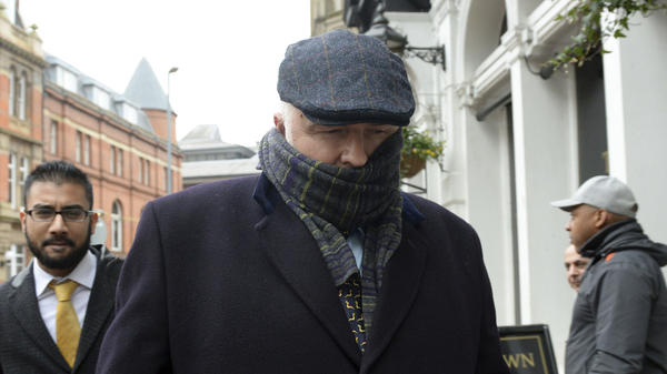 Simon Bramhall leaves Birmingham Crown Court in England on Friday. The British surgeon, who burned his initials into patients' livers during transplant operations, has been fined $13,600 and ordered to perform community service.