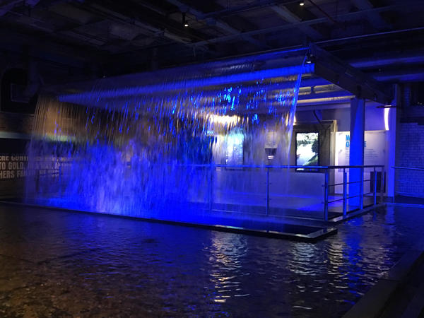 A waterfall bathed in blue light greets visitors at the Guiness Storehouse in Dublin — a symbol of the water from the nearby Wicklow Mountains that Guinness uses to brew its stout.