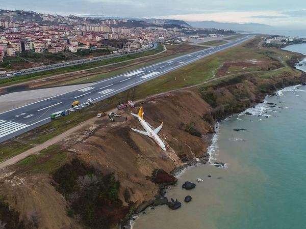 A Pegasus Airlines Boeing 737 passenger plane is seen stuck in mud on an embankment, a day after skidding off the airstrip, after landing at Trabzon's airport on the Black Sea coast on Jan. 14.