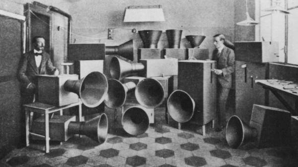 """The futurist artist Luigi Russolo (left)  with his noise machine, invented for futurist """"symphonies,"""" one of which was performed at the London Coliseum in June 1914."""