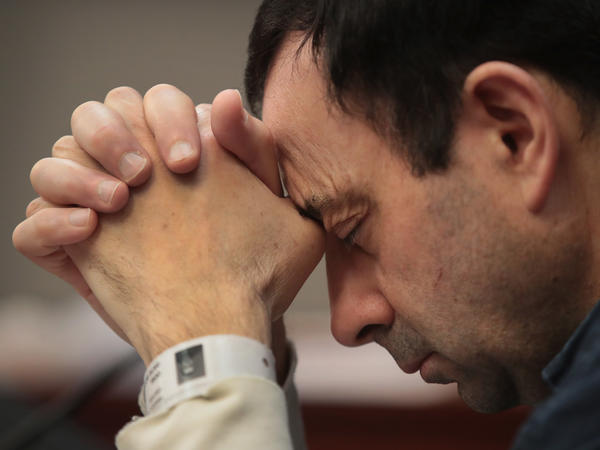 Larry Nassar listens to victim impact statements prior to being sentenced after being accused of molesting more than 140 women and girls while he was a physician for Team USA and Michigan State University. Nassar has pleaded guilty in Ingham County, Mich., to sexually assaulting seven girls, but the judge is allowing all of his accusers to speak.