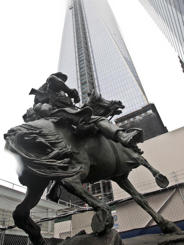 A statue of a soldier on horseback is unveiled during a ceremony near the World Trade Center Memorial site in New York on Oct. 19, 2012. The 16-foot-tall sculpture is a memorial to the troops who led the American invasion of Afghanistan in the weeks immediately after the Sept. 11 attacks in 2001.