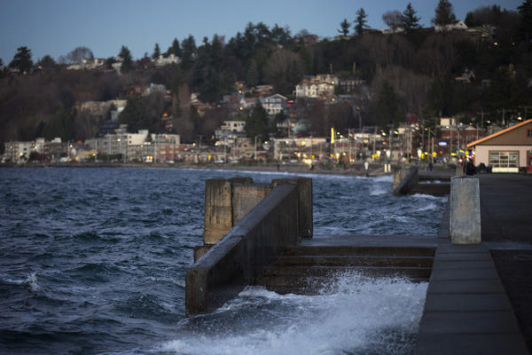 <p>Water spills over a set of stairs that typically lead to the beach during a King Tide at Alki Beach Park on Tuesday, December 5, 2017, in West Seattle. </p>
