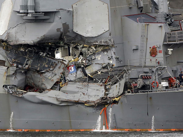 The damaged section of the USS Fitzgerald is seen at the U.S. naval base in Yokosuka, southwest of Tokyo.